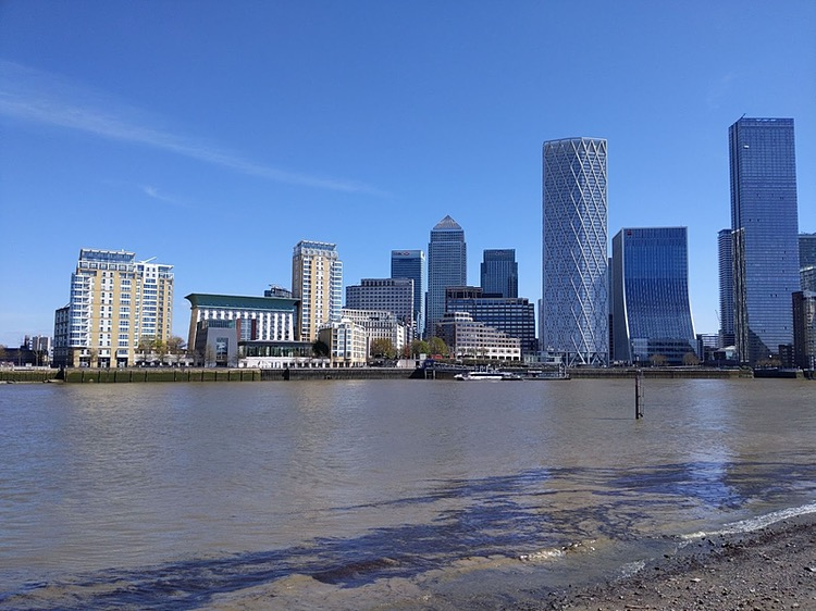 Photo of the modern Isle of Dogs from across the river, tall office tower blocks and lower apartment blocks