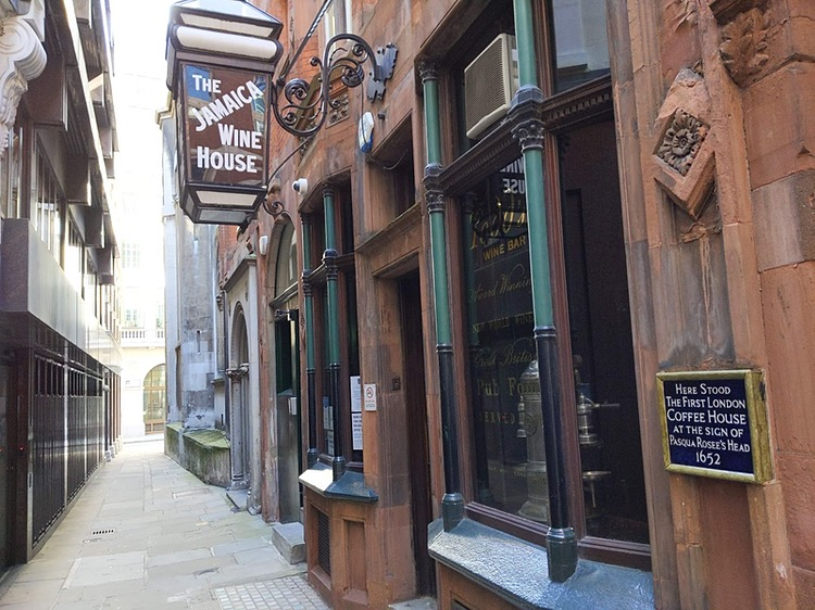 Photo of a narrow alleyway with a pub on the right, hanging outside of which is a large lantern with 'The Jamaica Wine House' written on it
